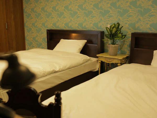 寝心地の良いホテル仕様のツインベットになっています。
