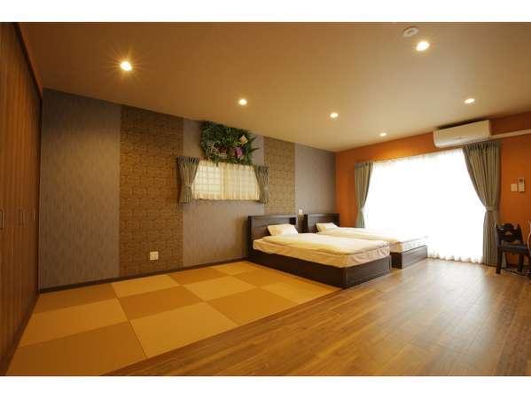 大人数で宿泊しやすいセミダブルベット2台に、広い畳間付き