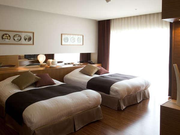 スイートルーム(70㎡):建築デザイナーによる上質なセンスで纏められた、2室だけのスイートルーム