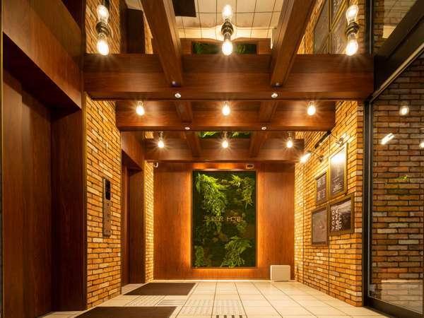 レンガ造りのエントランスは落ち着いた雰囲気♪いい香りでお客様をお迎えいたします♪