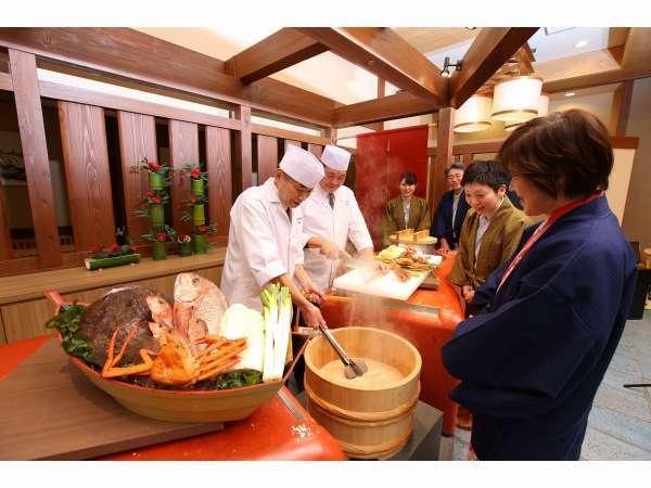 お食事処「味彩」にて、男鹿半島名物「石焼料理(イメージ)」を実演。