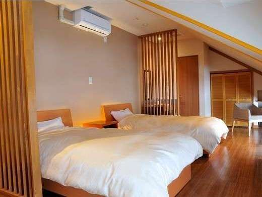 洋室のベッドは新潟で作っているファニーベット使用