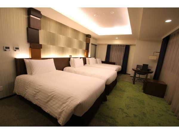 【デラックスツイン】面積54.4㎡2面の窓からシティビューを楽しめるホテル最上クラスのお部屋です。