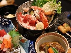 基本の【砂むし会席】。地元の海の幸を中心としたお料理です。(画像は一例)