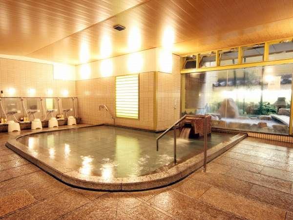 石を基調にした男性用大浴場。広々とした大浴場で旅の疲れを癒して下さいませ。