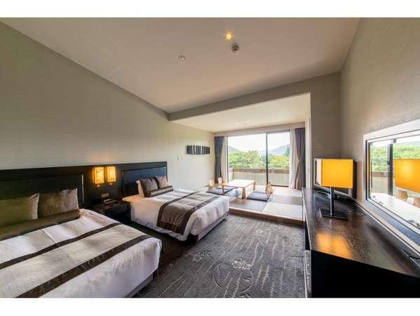 約40㎡の和洋室6畳間にセミダブルベッドが2台ついた客室