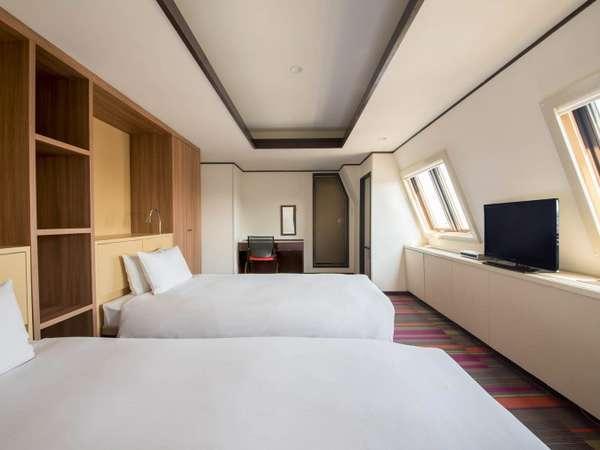最上階にある20平米ツインルームは3名様までご利用いただけます。