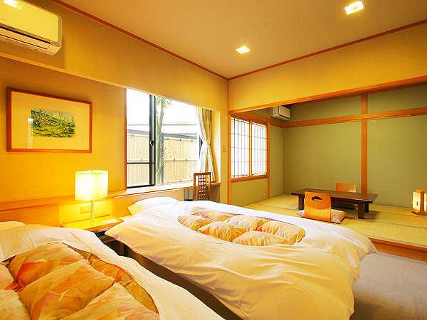 人気の和洋室は、ツインベッドと和室6畳(和室は襖の仕切りがあります)。