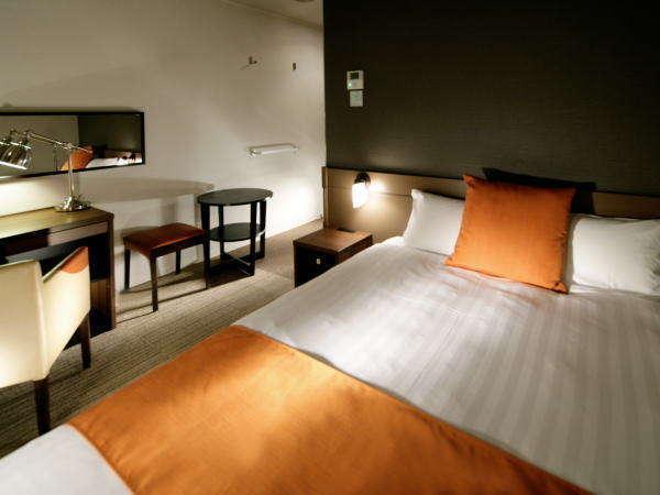 【デラックス】上質な寛ぎをテーマに、心地よさを提供する客室。