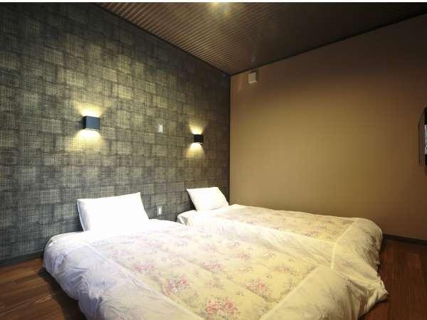 旅の疲れを癒してくれる寝室。随所に京都らしさを取り入れています。