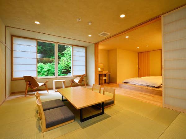 【Aタイプ】半露天風呂付き客室(一例)。窓の外には清流「日向見川」が流れます。