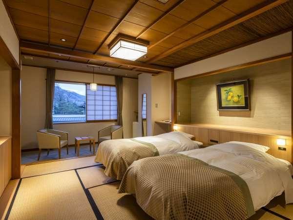 【和モダンベッドルーム】畳の間にゆったりと言置かれたベッドルーム