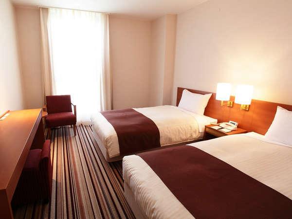 【ツインルーム】(21.2平米/禁煙室)上質なシモンズベットで心地よい眠りを提供いたします。