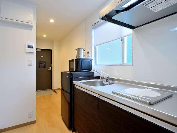 調理に便利なIH対応のシステムキッチンを装備(305号室)