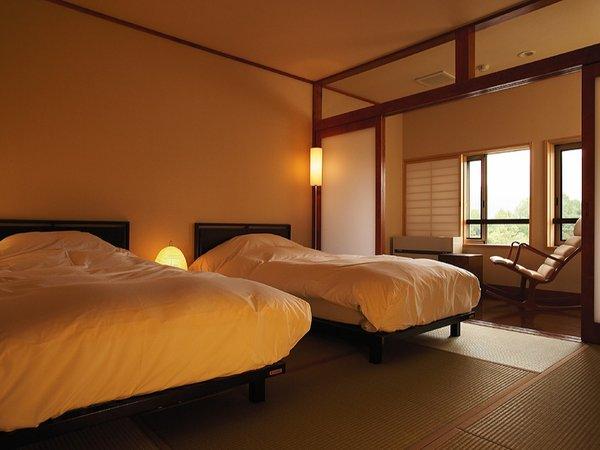 和洋室ベッドルーム(シングルベット2台)床は畳となります。