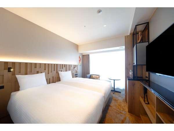 【スーペリアハリウッドツイン】110cm×200cmのベッドを2台隣接して並べています