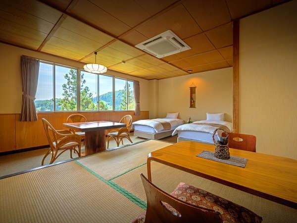 【乙女館】(和室8畳+ツインベッド)小上がりになった和室とツインベッドのある和洋室です