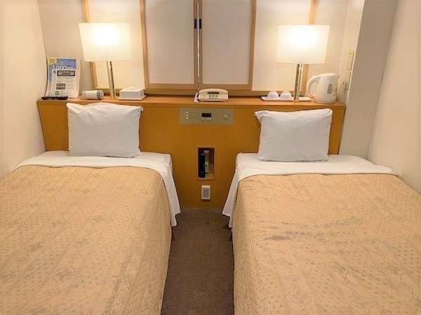 エコノミーツイン90cm幅シングルベッドが2台の コンパクトなお部屋です。
