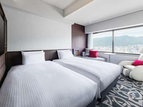 ツイン ●広さ:26平米 ●ベッド:幅110cm×長さ195cm 2台