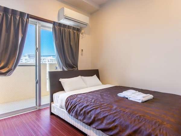 ダブルルーム/bedroom