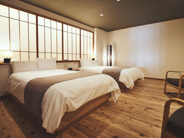ベッドルームのフローリングは『音響熟成木材』を使用。「生きた木」が持つ本来の力を生かした快適空間。