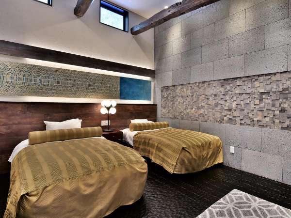 シモンズベッドを備えたメインルーム内のベッドルームの一例