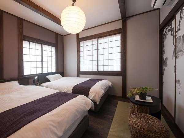 寝室シモンズ製ベッドを採用した和魂洋才