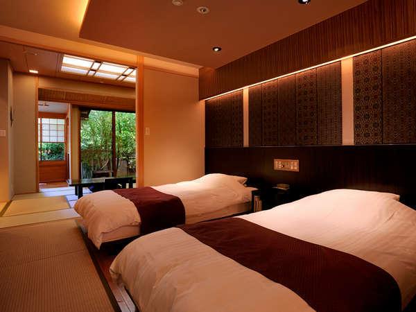 土筆のベッドルーム落ち着いた雰囲気で大島紬や久留米絣がポイント。