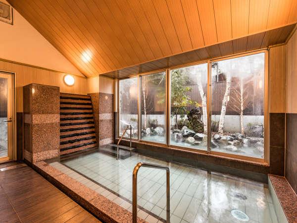 【大浴場】木目調の温かみの有る浴室