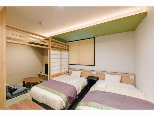 DXツイン ベッドと寛ぎのタタミスペースがございます。