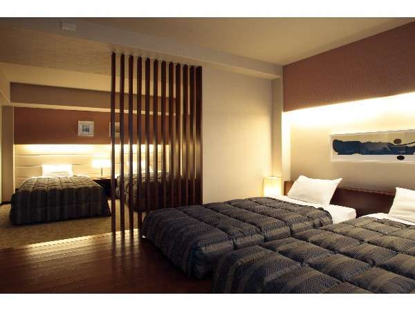 デラックスフォース:落着いた雰囲気のゲストルーム。74.7㎡(寝室)