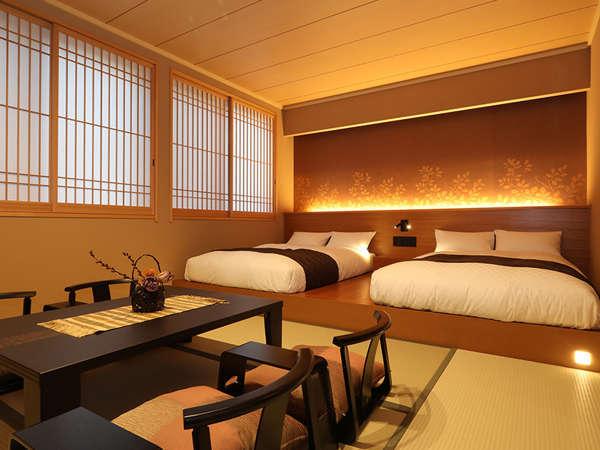 【デラックスルーム(東方館)】畳敷きに低層ベッドのお部屋でごゆっくりと旅の疲れを癒していただけます。