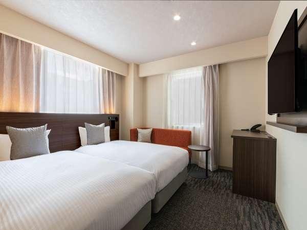 モデレートツイン・110CM幅ベッドX2台 愛媛の特産品【伊予柑】をイメージしたオレンジの客室
