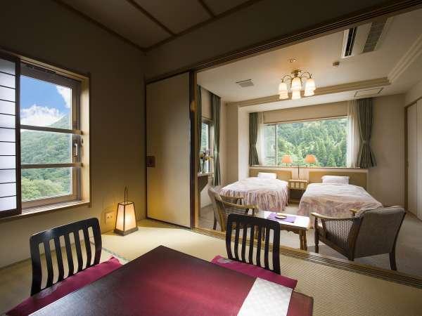 【和洋室一例】シングルベッド×2と和室6畳間のお部屋です。カップル&ファミリーに人気です!