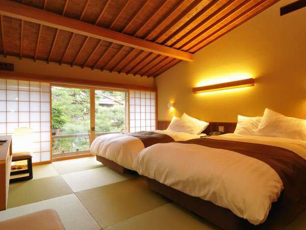 【客室一例】特別室ではベッドをご用意している客室もございます。