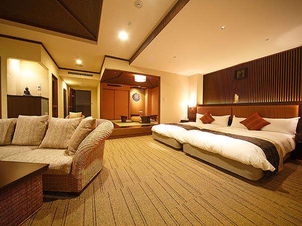 [オリエンタルルーム]南国リゾートスタイルの選び抜かれた調度品、安眠を約束するデュペスタイルの寝具。