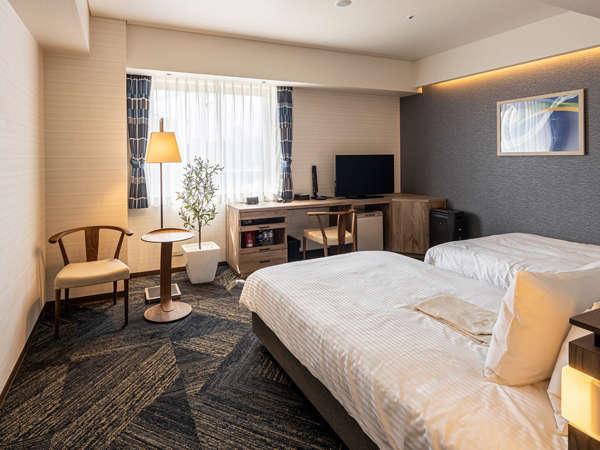新館:【禁煙】デラックスツイン・最上級ランク、2つのベッドに加え、インテリアともに心地よい空間に