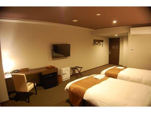 ツインルーム 広々空間と大きなベッドでごゆっくりとお寛ぎください