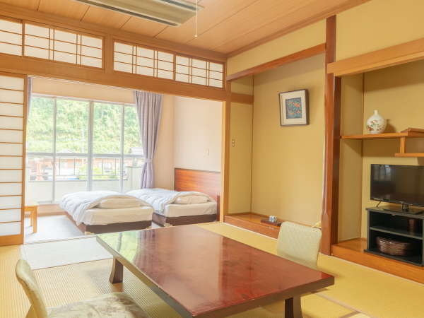 和洋室/ツインベッド+畳八畳でファミリーにオススメ!