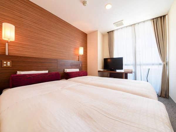 *ツインベッド(一例)ベッド幅100cmサイズのベッドを2台備えたツインルームです。
