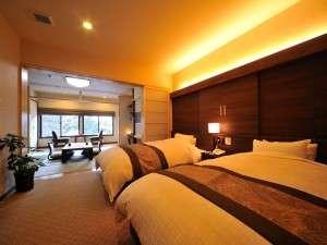 【2階 温泉付特別室】洋室にはセミダブルサイズのベッドが二つ