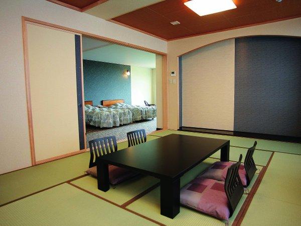 和洋室-和室。お部屋専用の露天風呂はいつでも気軽に薬石風呂がお楽しみいただけます。
