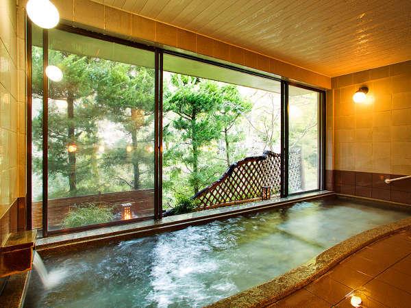 【天見温泉 極楽湯】天然ラジウム温泉。24時間ご入浴いただけます。窓一面に広がる緑をお楽しみ下さい