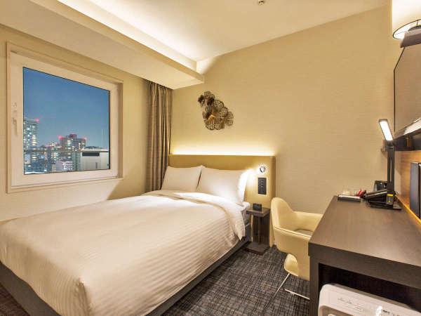 幅140cmのベッド、機能性を重視したレイアウトが織りなす快適ステイ ダブルルーム