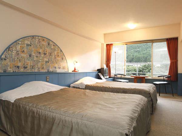 パークコテージ客室一例。気兼ねなく過ごせてカップルに人気のお部屋です。