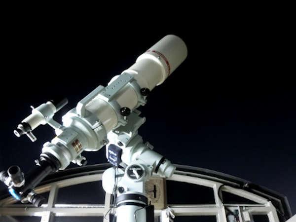 屋上の天体望遠鏡
