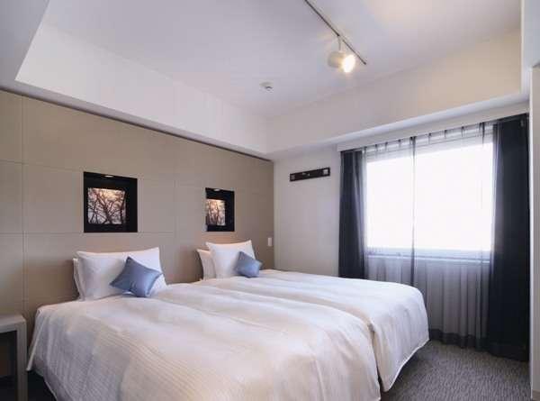 ハリウッドツインのベッド幅110cm。広さ19㎡。