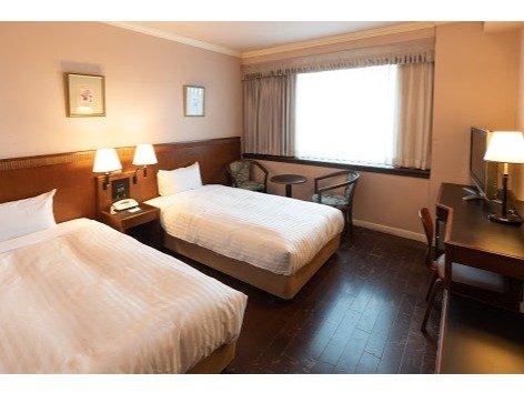ラージツイン(客室一例)19.4㎡のお部屋に100cm幅のベッドが2台入れたお部屋です