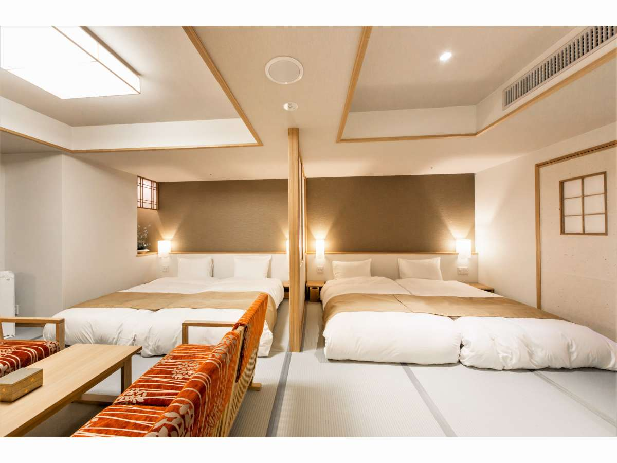 【客室】フォース:40㎡の空間にハリウッドツインタイプの和ベッドを2組並べた4名定員の客室です。