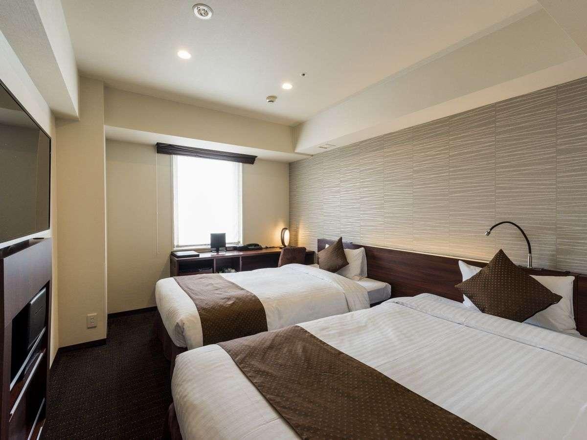 【ミニツイン 16平米】シングルベッドとエキストラベッドを採用。